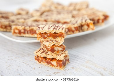 Crisp waffle wafer biscuits with caramel and walnut