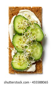crispbread with cream cheese and cucumber isolated on white background, top view
