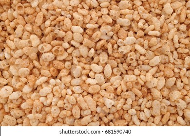 Crisped puffed rice breakfast cereal as an abstract background texture - close detail