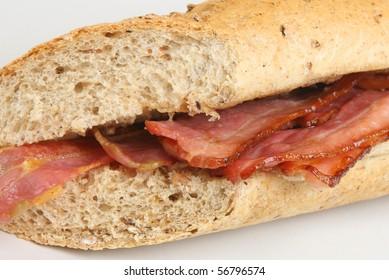 Crispy bacon in a granary baguette