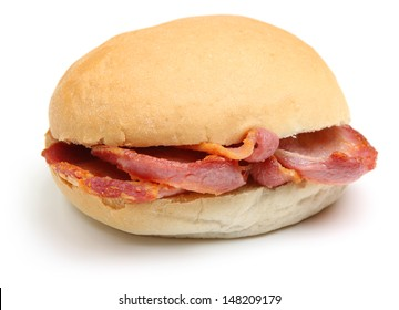 Crispy bacon in a soft white bread roll or bap.