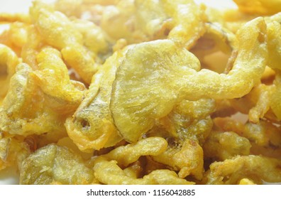 crispy batter-fried oyster mushroom with flour on dish