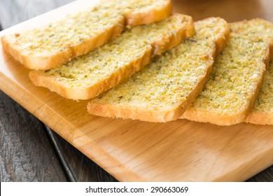 crispy bread garlic on wood background