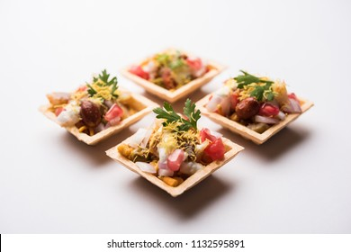 Crispy Canape or canapé is a starter recipe from India - Round or square shaped Puri Filled with Yogurt and potato , chat, sev, tamarind sauce etc. selective focus