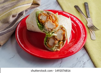 Crispy chicken Caesar salad wrap sandwich with romaine lettuce