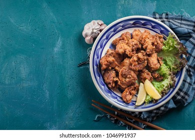 Crispy chicken karaage with lettuce. Popular japanese dish. Top view