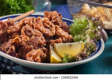 Crispy chicken karaage with lettuce. Popular japanese dish