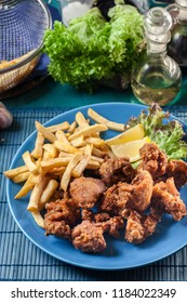 Crispy chicken karaage served with french fries. Popular japanese dish. Top view