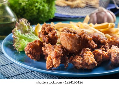 Crispy chicken karaage served with french fries. Popular japanese dish