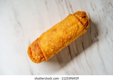 Crispy Chinese fried egg roll on marble counter