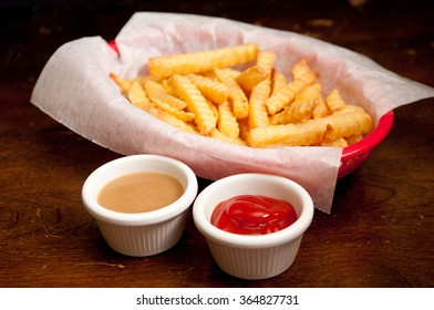 crispy crinkle cut french fries with gravy and ketchup