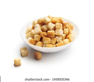 Crispy croutons in bowl isolated on white background