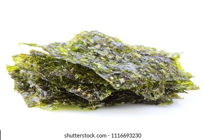 Crispy dried seaweed nori isolated close up on white background.