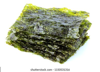 Crispy dried seaweed nori with salt isolated on white background.