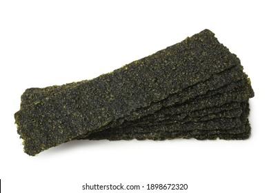 Crispy dried seaweed on white background