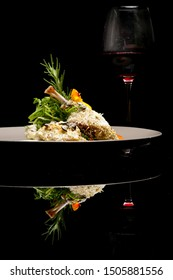 Crispy duck legs. Exquisite dish. Creative restaurant meal concept. Haute couture food on black with reflection. Fine dining concept.
