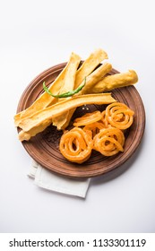 Crispy Fafda with sweet jalebi is an Indian snack most popular in Gujarat, selective focus