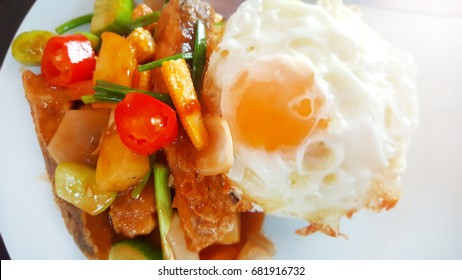 CRISPY FISH WITH SWEET AND SOUR SAUCE, SERVED WITH RICE AND FRIED EGG, Thai cuisine, Thai fast food