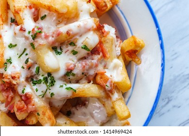 Crispy French fried potatoes loaded with bacon creamy ranch dressing and mozzarella cheese