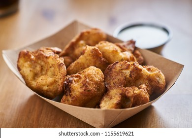 crispy fried cauliflower bites in brown paper tray