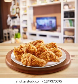 crispy fried chicken advertising menu in a wooden table
