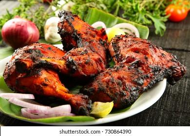 Crispy fried chicken in flame,