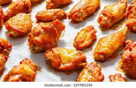Crispy fried chicken wings on the baking tray