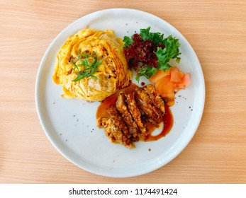 Crispy fried duck in teriyaki sauce served with thin omelette over white rice. Asian fusion food. Thai fusion dish. Delicious food. Food image.