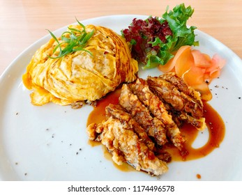 Crispy fried duck in teriyaki sauce served with thin omelette over white rice. Asian fusion food. Thai fusion dish. Delicious food. Food photo.