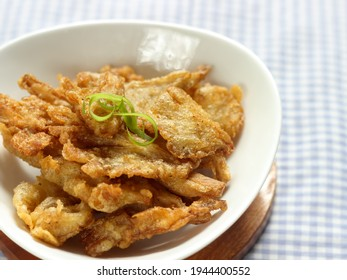 Crispy Fried Oyster Mushroom or Jamur Krispi. Oyster Mushroom Coated with Spiced Flour and Depp Fried. Usually Served with Tomato Sauce. Selective focus