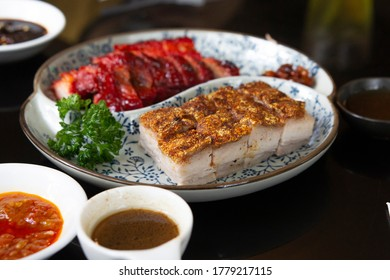 Crispy fried pork belly a famous Chinese food, Chinese food set. Famous Chinese cuisine dishes on table. Top view. Chinese restaurant concept. Asian style banquet