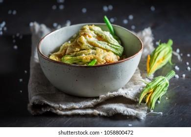 Crispy fried zucchini flower served with salt