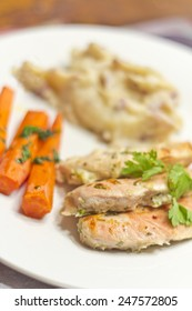 Crispy Greek yogurt baked chicken with roasted carrots home style mashed potatoes and a glass of red wine