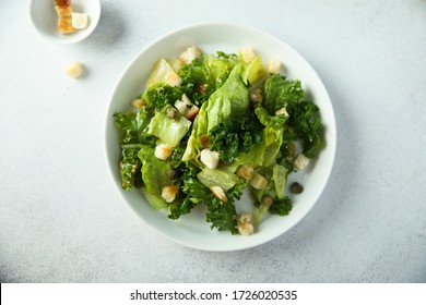 Crispy green salad with croutons and capers