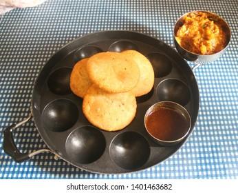 Crispy kachori served with potato curry and sweet sauce