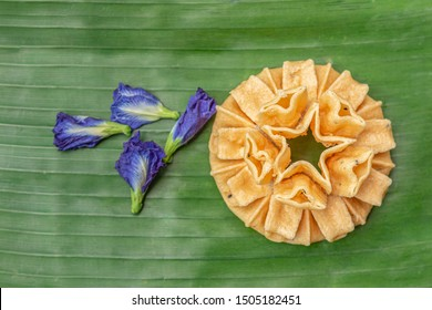 Crispy lotus blossom cookies isolated on white. Thai traditional snack. Top view. Thai homemade cookies.