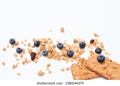 Crispy muesli cookies and blueberry Breakfast cereals isolated on white background, selective focus, top view.