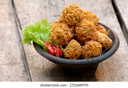 crispy noodle balls served on bowl, also known as bola bola mie