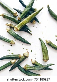 Crispy okra chips on a white background, top view