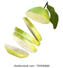 Crispy pearl guava fruit slices falling, isolated on a white background