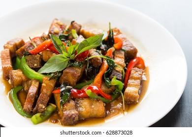Crispy pork with basil close up