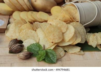 Crispy potato chips with salt and fresh potato