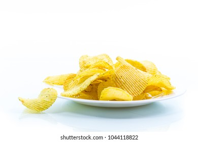 Crispy potato chips in a white plate on a white background