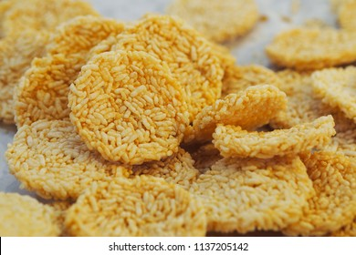 Crispy rice, Khanom Nang Let or Thai Rice Cracker, Snack made of rice, dried and Deep fried in oil.