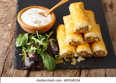 Crispy rolls borek stuffed with minced meat and eggs close-up on the table. horizontal