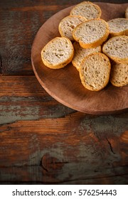 Crispy rusk slices on wooden cutting board
