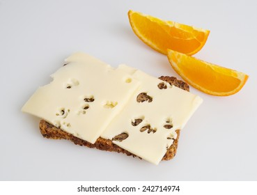 Crispy rye bread with cheese and orange