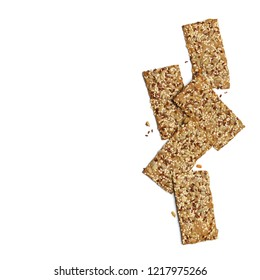 Crispy rye flatbread crackers with sesame and sunflower seeds isolated on white background. Top view point.