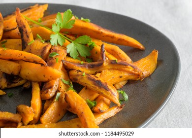 Crispy sweet potato fries in ceramic dish.