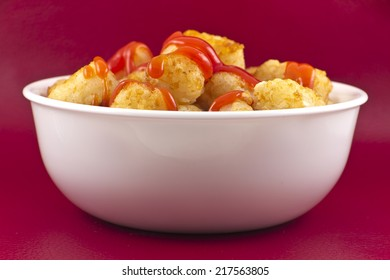 Crispy tater tots studio shot with fork and ketchup